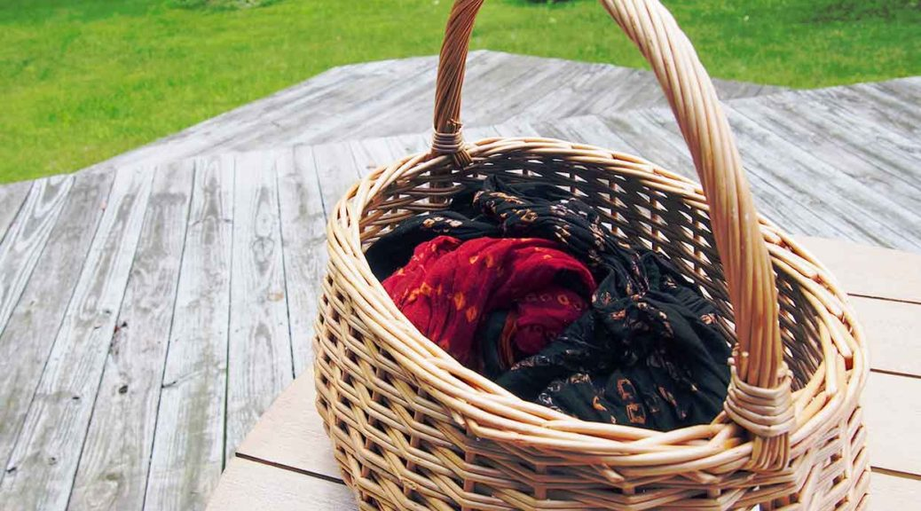 Basket, dupatta, camera, table, deck, yard